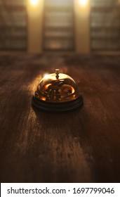 Concierge hotel bell on a wooden background / 3D rendering, illustration