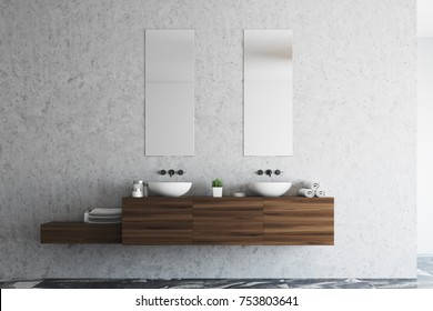 Concrete bathroom interior with a marble floor, a double sink with a wooden shelf and two narrow vertical mirrors. 3d rendering