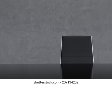 Concrete Dark Room with Chair and Table