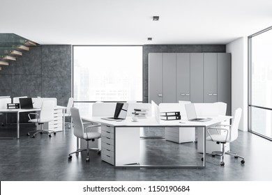 Concrete and white walls office interior with a concrete floor, loft windows and white computer tables. 3d rendering mock up
