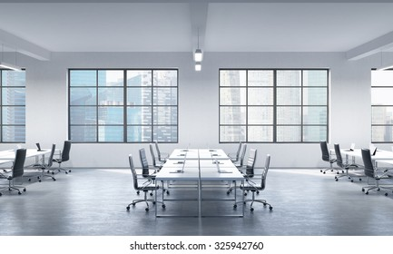 A conference room or corporate workplaces equipped by modern laptops in a modern panoramic office in Singapore. Black leather chairs and a white table. 3D rendering.