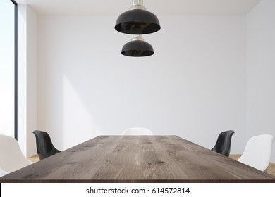 Conference room interior with a long wooden table surrounded by black and white chairs and massive ceiling lamps hanging above it. 3d rendering, mock up