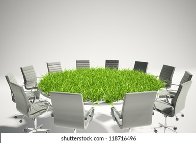 Conference table covered with grass - business outlook concept