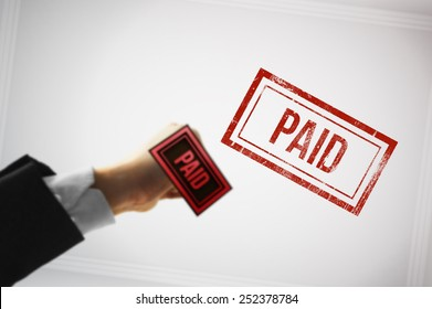 Confirm a payment with a Red paid stamp