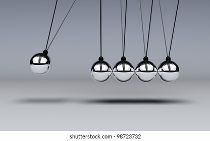 Conservation of energy is demonttrated with a Newtons Cradle in motion