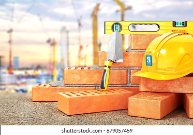 Construction concept. Part of brick wall in construction process with construction tools on a blurred construction site background. 3d illustration