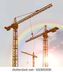 Construction cranes and rainbow Computer generated 3D illustration