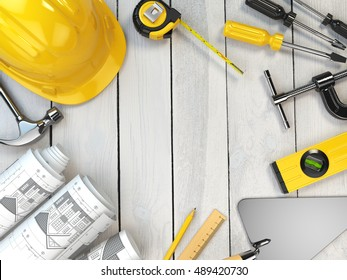 Construction tools on a wooden background. Hard helmet,  trowel, drawing and level with space for text. 3d illustration