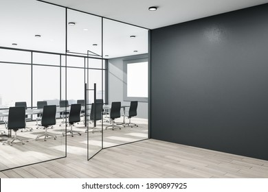Contemporary conference room with meeting table and blank black wall.  Workplace and presentation concept. Mock up. 3D Rendering