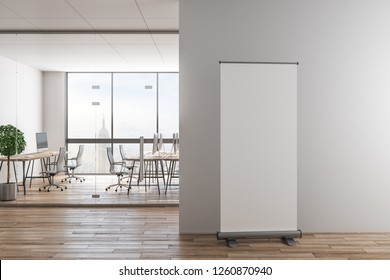 Contemporary office interior with empty poster on wall, furniture and city view. Mock up, 3D Rendering