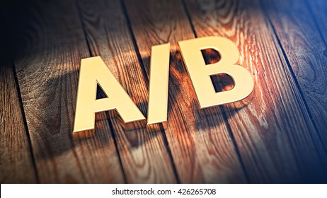 "Conversion split test concept. Acronym ""A/B"" is lined with gold letters on wooden planks. 3D illustration image"