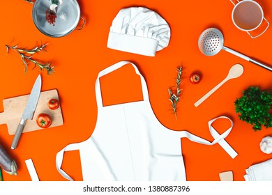 Cook apron, vegetables. cutting board, utensils, toque, grater. 3d rendering.
