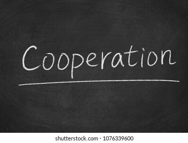 cooperation concept word on a blackboard background