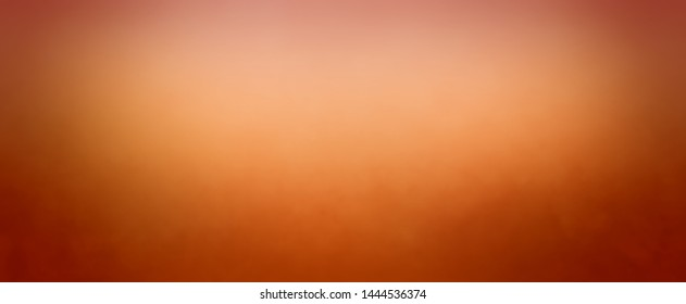 Copper orange red and brown autumn background colors with faint mottled border texture and bright blurred center spotlight design