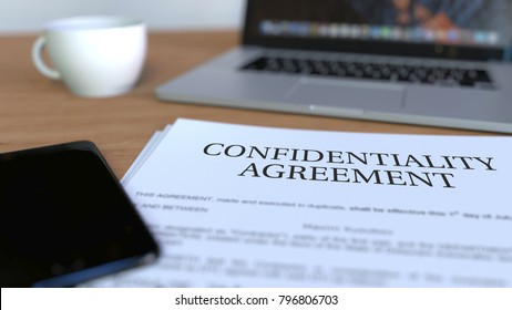Copy of confidentiality agreement on the desk. 3D rendering