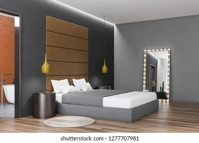 Corner of bedroom with gray walls, wooden floor, gray master bed with round bedside tables and mirror with ligth bulbs. 3d rendering