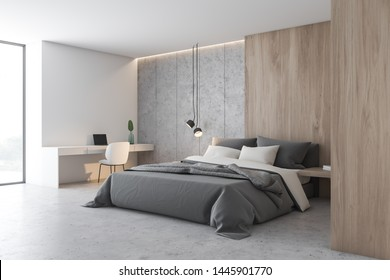Corner of bedroom with white, stone and wooden walls, concrete floor, master bed and white home office area with table and laptop. 3d rendering