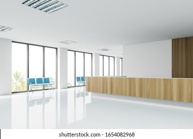 Corner of clean modern hospital corridor with big windows, rows of blue chairs and wooden reception desk. Concept of healthcare. 3d rendering