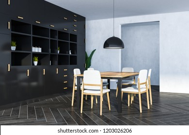 Corner of dining room with white walls, wooden floor, long table with chairs and black cupboard. 3d rendering