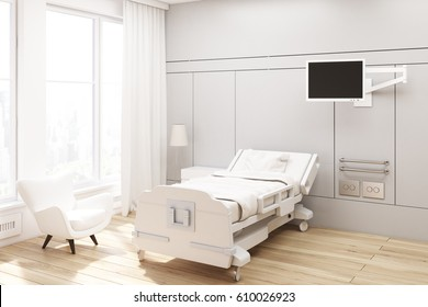 Corner of a hospital ward with gray walls, a bed, a tv set, a white armchair and curtains on large windows. 3d rendering, Mock up