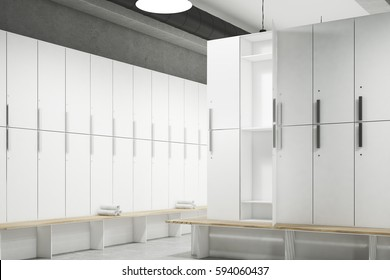 Corner of a locker room with gray walls, a row of wooden storage lockers near the wall and a bench with rolled towels on it. 3d rendering. Mock up.
