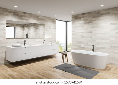 Corner of loft bathroom with light tiled walls, wooden floor, comfortable bathtub and double sink on white countertop with big mirror. 3d rendering