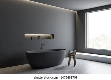 Corner of minimalistic bathroom with gray walls, concrete floor, comfortable grey bathtub and shelf with mirror and creams. 3d rendering