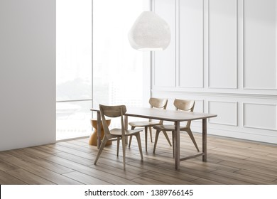 Corner of minimalistic white dining room with white floor, wooden table with chairs and stylish ceiling lamp above it and large window. 3d rendering