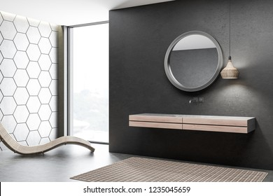 Corner of modern bathroom with black and gray honeycomb pattern walls, concrete floor and white double bathroom sink standing on wooden countertop. Round mirror and wooden armchair. 3d rendering