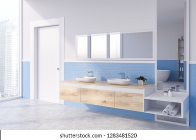 Corner Of Modern Bathroom With White And Blue Brick Walls, Concrete Floor  And Double Sink