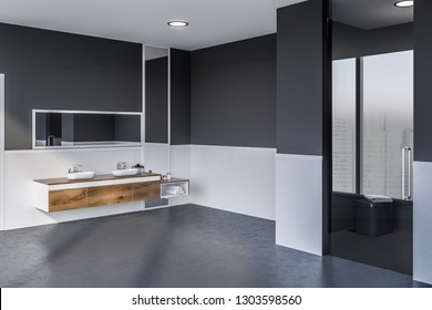 Corner of modern bathroom with white and gray walls, concrete floor, double sink standing on wooden countertop with vertical and horizontal mirror above it and glass shower door. 3d rendering