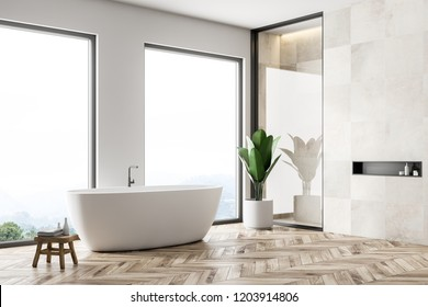 Corner of modern bathroom with white tile walls, wooden floor, and white bathtub. Loft windows. 3d rendering