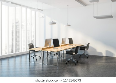 Corner of a modern consulting company office with panoramic windows with a city view, a concrete floor and wooden computer desks standing in a row. 3d rendering mock up