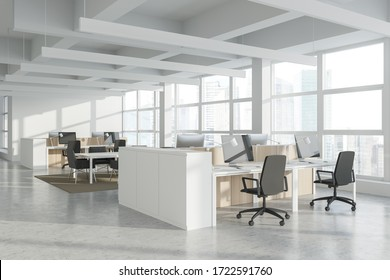 Corner of modern Industrial style open space office with white walls, concrete floor, rows of computer tables and panoramic windows with blurry cityscape. 3d rendering