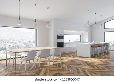 Corner of modern kitchen with white walls, wooden floor, white bar with wooden stools and white countertops with built in sink and cooker. Wooden table with chairs. 3d rendering