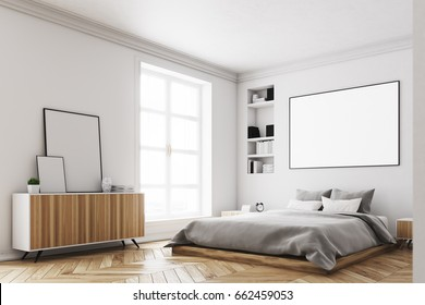 Corner of a modern luxury bedroom with white walls, a large bed in the center of the room, two bookcases by its sides, a large window and a framed horizontal poster. 3d rendering mock up