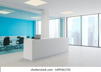 Corner of modern office with blue glass and white walls, concrete floor, white reception desk with laptop and meeting room with long table and black chairs. 3d rendering