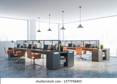 Corner of modern office with white walls, concrete floor, panoramic windows and long gray and wooden computer tables with orange chairs. Interior design concept. 3d rendering