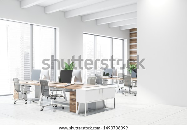 Corner of modern open space office with wooden walls, tiled floor, rows of wooden computer desks with black chairs and mock up wall to the right. 3d rendering