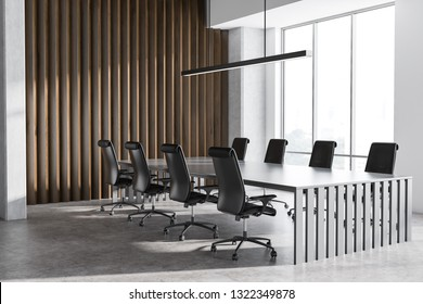 Corner of office conference room with concrete and wooden walls, concrete floor, large window and long gray table with black chairs. 3d rendering