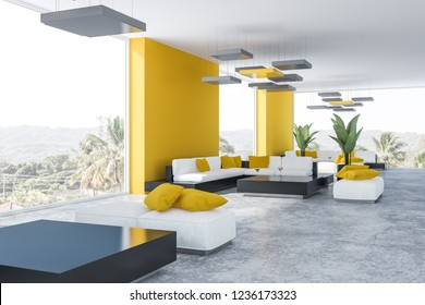 Corner of office lounge with yellow walls, concrete floor and white sofas standing near black coffee tables. 3d rendering