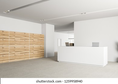 Corner of office reception area with white walls, carpet on floor, white reception desk with laptops and wooden lockers. Office in the background. 3d rendering