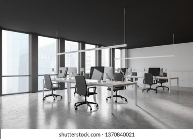 Corner of open space office with gray and white walls, concrete floor, rows of white computer tables, cabinets and large windows with cityscape. 3d rendering