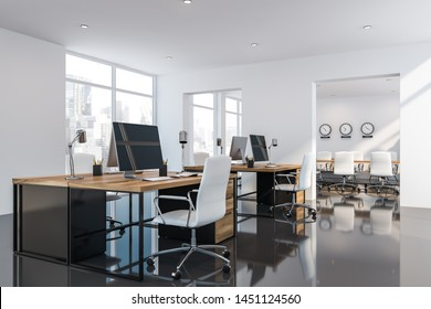 Corner of open space office with white walls, black glossy floor, wooden computer tables and big windows with cityscape. Meeting room with clocks in background. 3d rendering