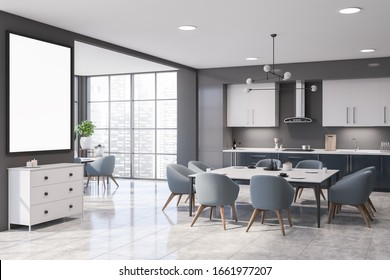 Corner of panoramic kitchen with gray walls, tiled floor, dark blue countertops and white cupboards. Dining table with blue chairs in the center. Vertical mock up poster. 3d rendering