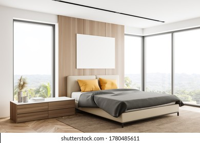Corner of panoramic master bedroom with white and wooden walls, wooden floor, comfortable king size bed with yellow pillows and windows with blurry tropical view. Mock up poster. 3d rendering