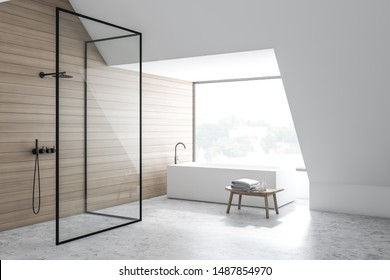 Corner of stylish bathroom with white and wooden walls, concrete floor, angular bathtub and vertical shower stall with glass walls. 3d rendering