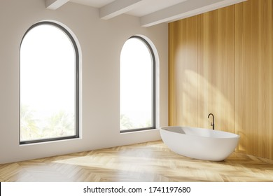 Corner of stylish bathroom with white and wooden walls, wooden floor, arched windows with blurry tropical view and comfortable bathtub. 3d rendering