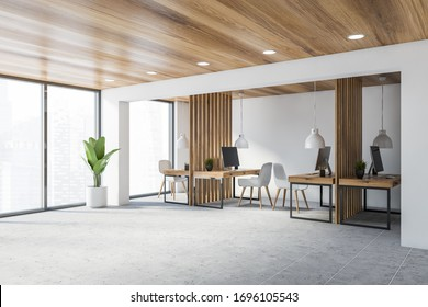 Corner of stylish consulting company office with white walls, wooden ceiling, tiled floor and wooden computer tables with white chairs. Blurry cityscape. 3d rendering
