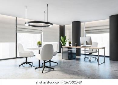 Corner of stylish panoramic CEO office with grey walls, columns, concrete floor, gray and wooden computer desk and round coffee table with white armchairs. Blurry city. 3d rendering